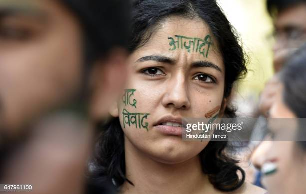 A students Azadi word paint on her face During the citizens protest march for Justice and Save Delhi University end to Gundagardi Mandi house to...