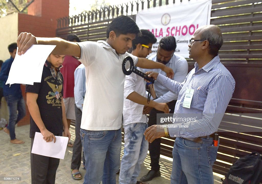 Students being checked and asked to remove their shoes and other accessories before entering the examination center for 'National Eligibility Entrance Test' (NEET) exam for admissions to MBBS and BDS courses, at Kerala School, on May 1, 2016 in New Delhi, India. She was not allowed to enter the examination hall. The Supreme Court had on Saturday said that the entrance test for admission to MBBS and BDS courses for the academic year 2016-17 will be held as per the schedule through the two-phased common entrance test NEET on May 1 and July 24.