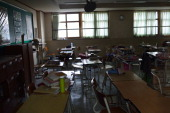Students' belongings remain on their desks as they left them in a second year classroom at Danwon High School on April 18 2014 in Ansan South Korea...