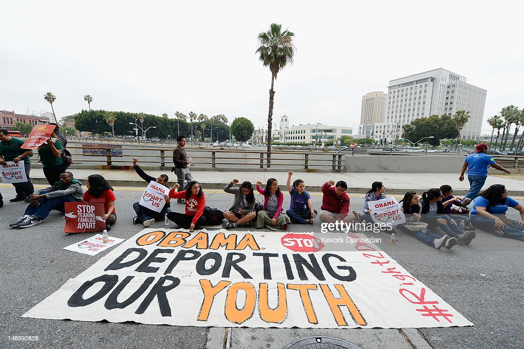 Students block a a street around the Los Angeles Federal Building during a demonstration by immigrant students for an end to deportations and urge relief by governmental agencies for those in deportation proceedings on June 15, 2012 in Los Angeles, California. In a policy change, the Obama administration said it will stop deporting young illegal immigrants who entered the United States as children if they meet certain requirements.