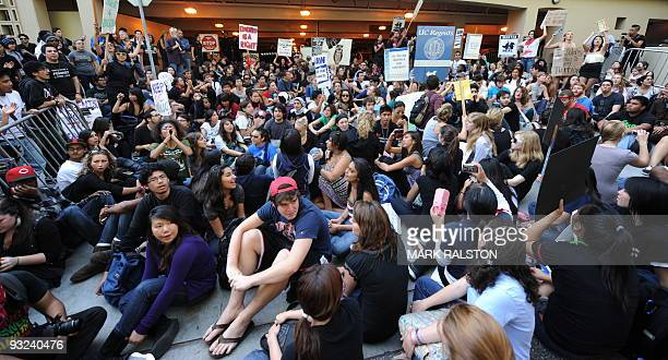 Students block a carpark entrance during a protest against an increase in student fees at the UCLA campus in Los Angeles on November 19 2009 The...