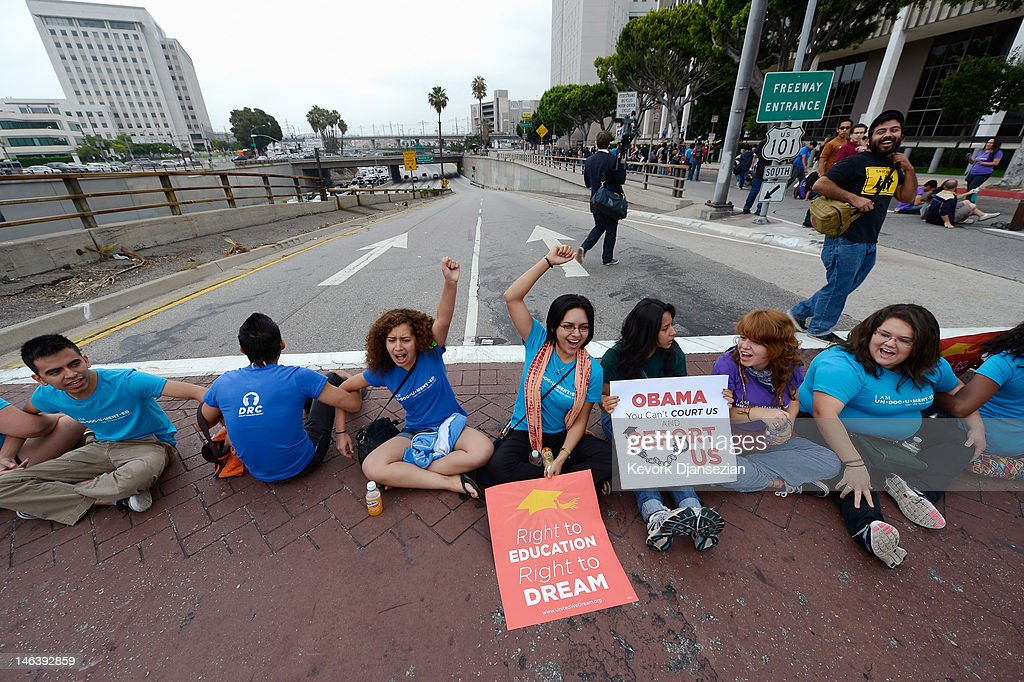 Students block a on ramp to the US101 during a demonstration by immigrant students for an end to deportations and urge relief by governmental agencies for those in deportation proceedings on June 15, 2012 in Los Angeles, California. In a policy change, the Obama administration said it will stop deporting young illegal immigrants who entered the United States as children if they meet certain requirements.