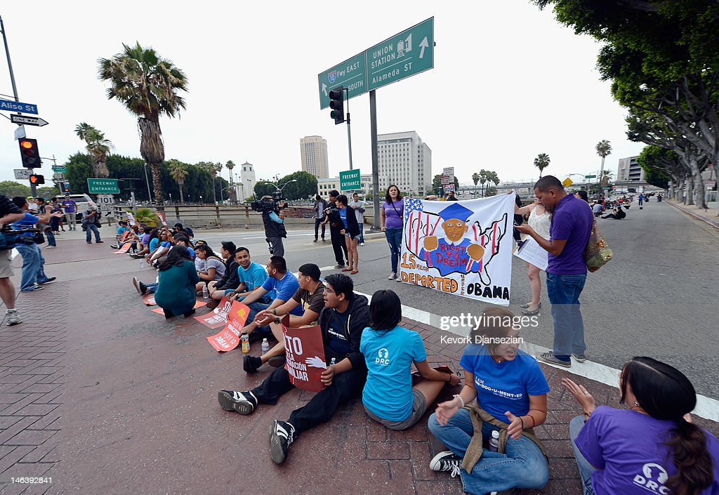 Students block a street around the Los Angeles Federal Building and the on ramp of US101 freeway during a demonstration by immigrant students for an end to deportations and urge relief by governmental agencies for those in deportation proceedings on June 15, 2012 in Los Angeles, California. In a policy change, the Obama administration said it will stop deporting young illegal immigrants who entered the United States as children if they meet certain requirements.