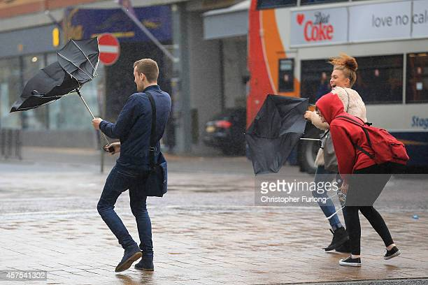 Students brave high winds and rain on Blackpool promenade as Britain prepares for high winds over the next two days on October 20 2014 in Blackpool...