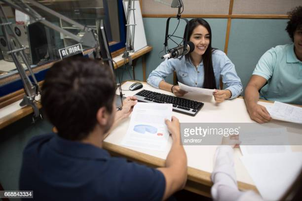 Students broadcasting from the university's radio station