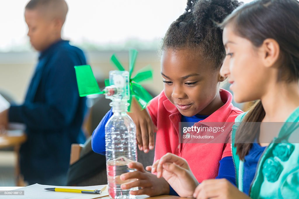 Students building windmill during elementary science class : Stock Photo