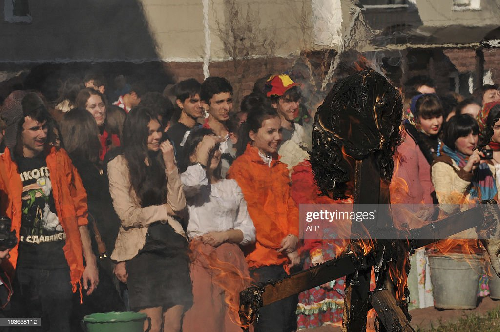 MARCH 14, 2013-- Students burn a straw doll as they celebrate Maslenitsa, or Shrovetide, in the southern Russian city of Stavropol, on March 24, 2013. AFP PHOTO / DANIL SEMYONOV