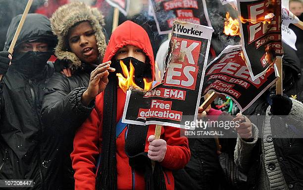 Students burn placards as they demonstrate in Trafalgar Square in central London on November 30 2010 More than 1000 students took to the streets of...