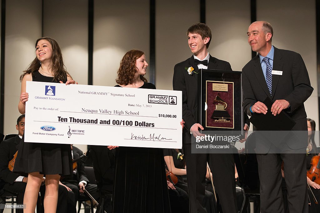 Students Caroline Brown, Mary Beth McMullan, Corey Worley and Principal Dr. Robert McBride attend the GRAMMY Signature School Presentation. Neuqua Valley High School was honored as a National GRAMMY Signature School and received an award of $10,000 at Neuqua Valley High School on May 7, 2013 in Naperville, Illinois.
