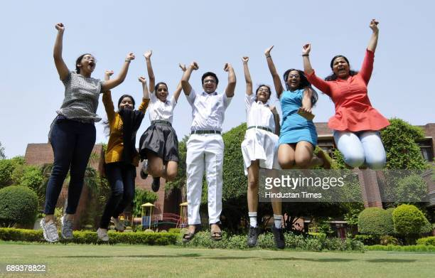 Students celebrate after the CBSE class 12th results 2017 announced at Amity International School on May 28 2017 in Noida India A total of 19397...