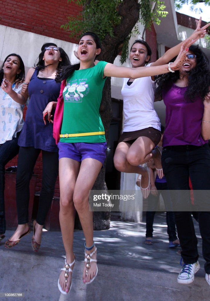 Students celebrate after their Class XII CBSE board results were announced in New Delhi on May 21, 2010.