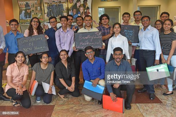 Students celebrate as they get their visa to study in USA during the Student Visa Day at US Consulate General BKC on June 8 2017 in Mumbai India The...