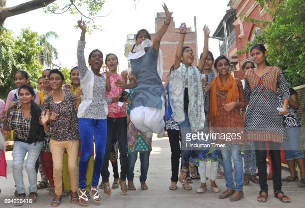 Students celebrate at Bipin Bihari Inter College after the UP Board declared class 10th and 12th results on June 9 2016 in Varanasi India A total of...