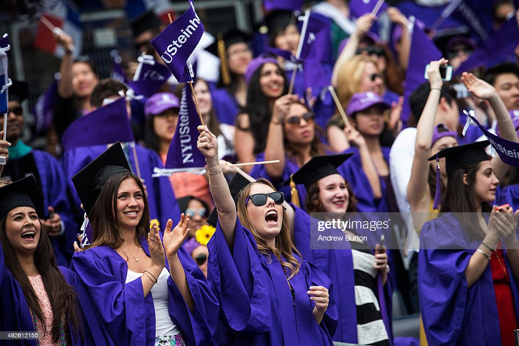 Students celebrate at the commencement of the 2014 New York University graduation ceremony at Yankee Stadium on May 21, 2014 in the Bronx borough of New York City. Janet Yellen, Chair of the Board of Governors of the Federal Reserve System, received an honorary doctorate and was the 2014 commencement speaker.