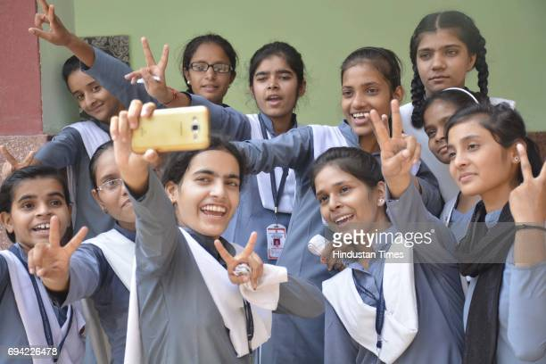 Students celebrate UP Board results for Class 10 and Class 12 on June 9 2016 in Ghaziabad India A total of 3404571 students appeared for the UP Board...