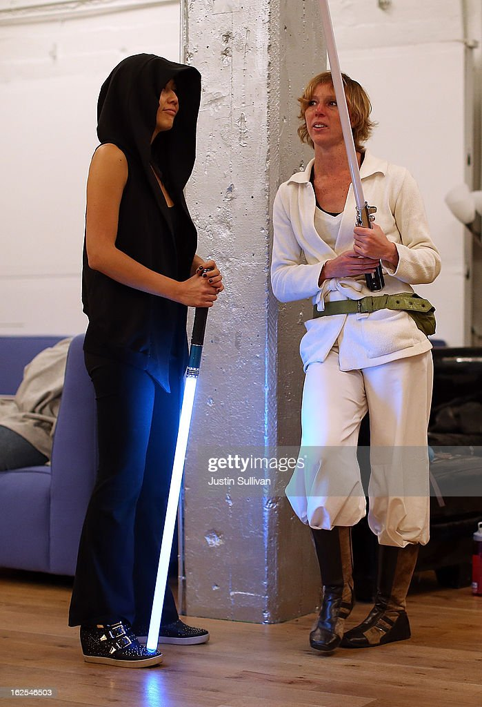 Students Chandra Gilmore (R) and Carol Wong (L) take a break during a Golden Gate Knights class in saber choreography on February 24, 2013 in San Francisco, California. Star Wars fans Alain Bloch and Matthew Carauddo founded the Golden Gate Knights in 2011 to teach classes on how to safely wield a lightsaber and perform choreographed moves. The three hour class costs ten dollars and all equipment is provided.