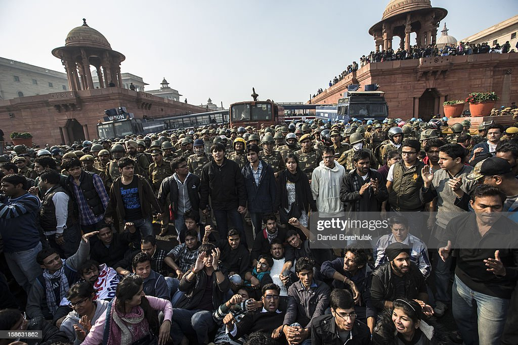 Students chant anti-police slogans as they form a line in front of cordon of Police dressed in riot gear during a protest against the Indian governments reaction to recent rape incidents in India in front of Rashtrapati Bhavan or the Presidential Palace on December 22, 2012 in New Delhi, India. Thousands of students gathered in front of the Presidential Palace in New Delhi to protest against current rape laws and the governments dealings of recent rape cases all over India.