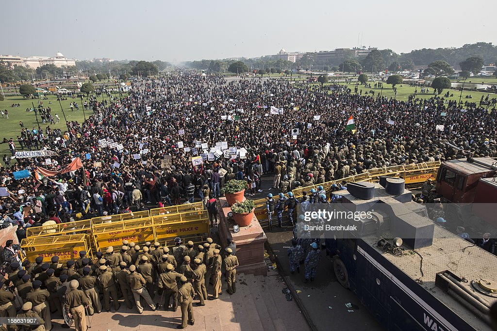 Students chant anti-police slogans as they form a line in front of cordon of Police during a protest against the Indian governments reaction to recent rape incidents in India in front of Rashtrapati Bhavan or the Presidential Palace on December 22, 2012 in New Delhi, India. Thousands of students gathered in front of the Presidential Palace in New Delhi to protest against current rape laws and the governments dealings of recent rape cases all over India.