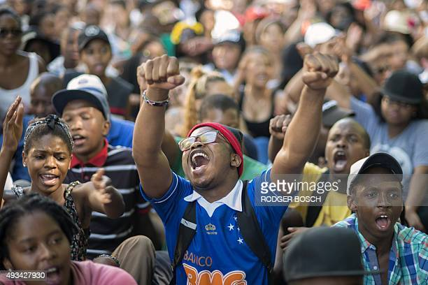 Students chant slogans during a protest against fee hikes at the University of Cape Town on October 20 2015 Student protests halted teaching at three...