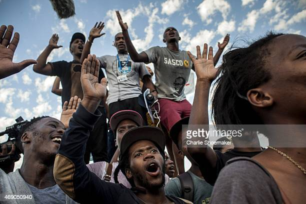 Students cheer after the Cecil Rhodes statue was removed from the University of Cape Town on April 9 2015 in Cape Town South Africa The statue of...