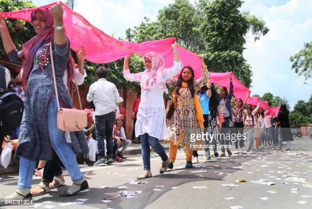 Students cheer and campaign on the polling day for the Rajasthan University's Student Union Elections at Maharani College on August 28 2017 in Jaipur...