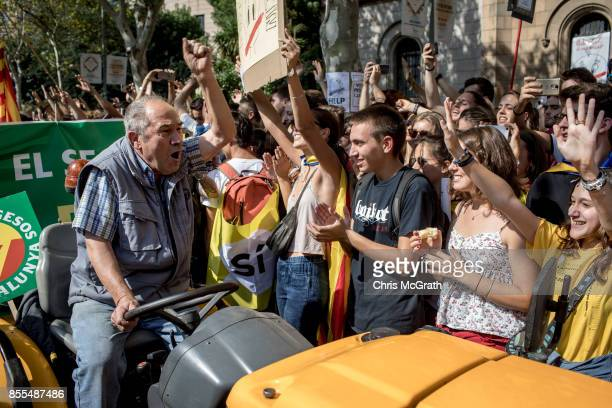 Students cheer and shout slogans as they join a farmers union protest supporting the Yes vote outside the University of Barcelona on September 29...