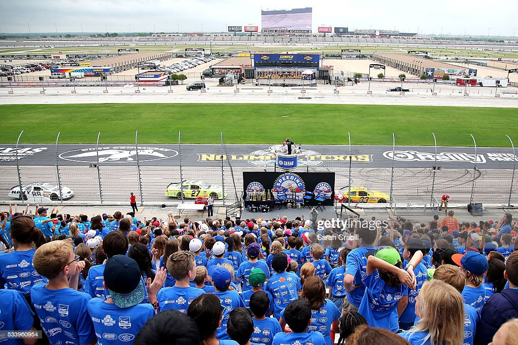 Students cheer during the Speeding To Read Championship Assembly at Texas Motor Speedway on May 24, 2016 in Fort Worth, Texas.