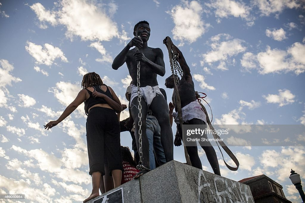 Students cheer from where the Cecil Rhodes statue stood moments before after it was removed from the University of Cape Town on April 9 2015 in Cape...