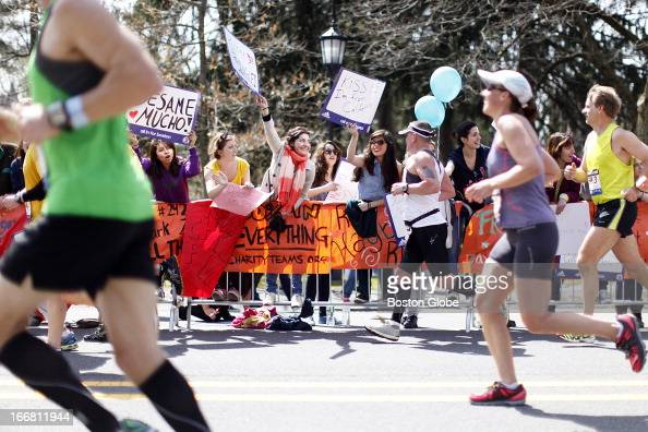 Students cheered on runners at Wellesley College The 117th Annual Boston Marathon makes its way by Wellesley College on Route 135 in Wellesley Mass...