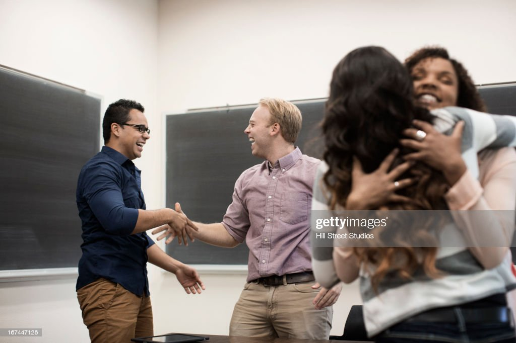 Students cheering in classroom : Stock Photo
