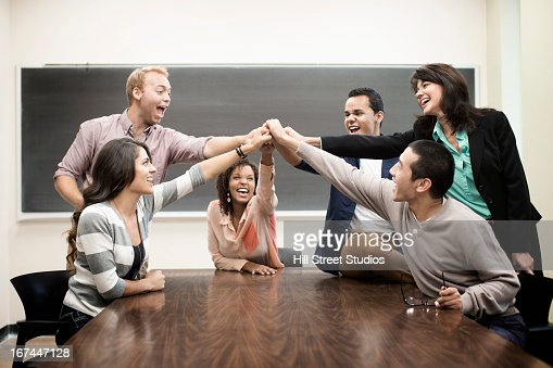 Students cheering in classroom