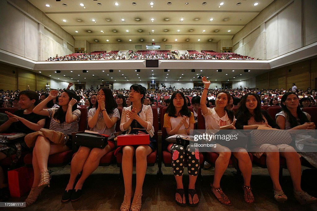 Students clap and wave during a question and answer session with Sheryl Sandberg, chief operating officer of Facebook Inc., unseen, during her visit to Yonsei University in Seoul, South Korea, on Wednesday, July 3, 2013. Sandberg is in South Korea to promote her book 'Lean In: Women, Work, and the Will to Lead.' Photographer: Woohae Cho/Bloomberg via Getty Images