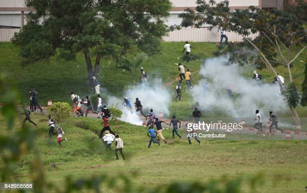 TOPSHOT Students clash with Ivorian police officers during a demonstration against rising education costs at the Felix Houphouet Boigny University on...
