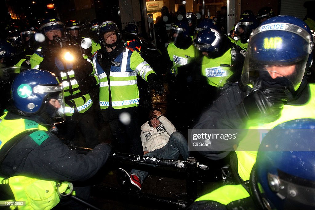 Students clash with police as they take part in a protest over the Government's budget cuts and proposed rise in tuition fees on November 30, 2010 in London, England. Hundreds of students evaded police containment tactics and marched throughout Westminster and the City of London from Trafalgar Square in the third major protest of its kind in London in as many weeks.