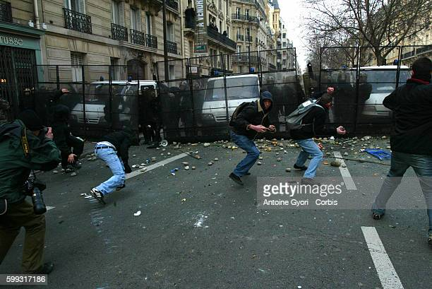 Students clash with riot police in Paris after thousands of students demonstrated during the day to protest the implementation of Dominique de...