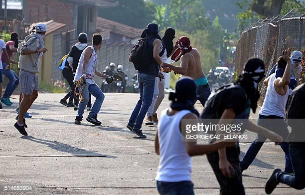 Students clash with riot policemen during a protest against Venezuelan President Nicolas Maduro in San Cristobal Venezuela on March 10 2016...