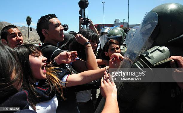 Students clash with riot policemen during a protest claiming free public education through college in Copiapo Chile on October 13 2011 AFP...