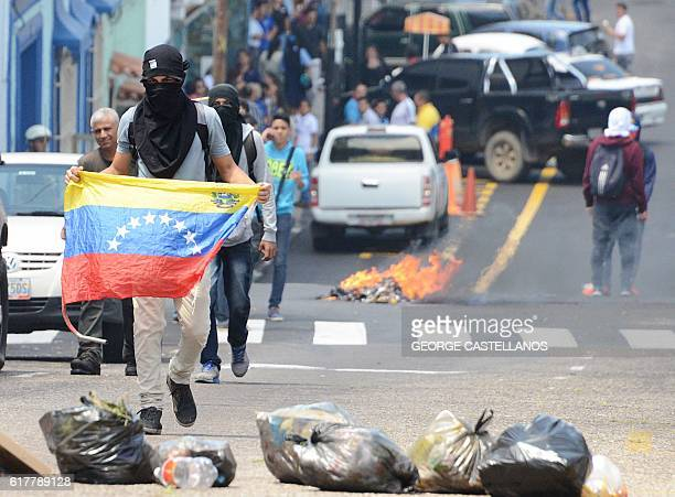 Students clash with riot policemen during a protest in San Cristobal state of Tachira Venezuela on October 24 2016 Secretary General of the...