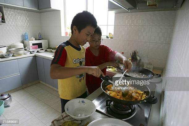 Students cook lunch by themselves at the Meng Mu Tang on August 4 2006 in Shanghai China Meng Mu Tang named after the mother of famed Chinese...