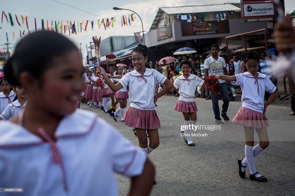 Students dance during the Tanauan Fiesta, Pasaka Parade on August 14, 2014 in Tanauan, Leyte, Philippines. Residents of Tacloban city and the surrounding areas continue to focus on rebuilding their lives nine months after Typhoon Haiyan struck the coast on November 8, 2013, leaving more than 6000 dead and many more homeless. With many businesses and government operations back up and running and with the recent start of the years typhoon season, permanent housing continues to be the main focus with many families still living in temporary accommodation. As well as continuing recovery efforts Leyte is preparing for the arrival of Pope Francis, who will visit the region from January 15- 19.