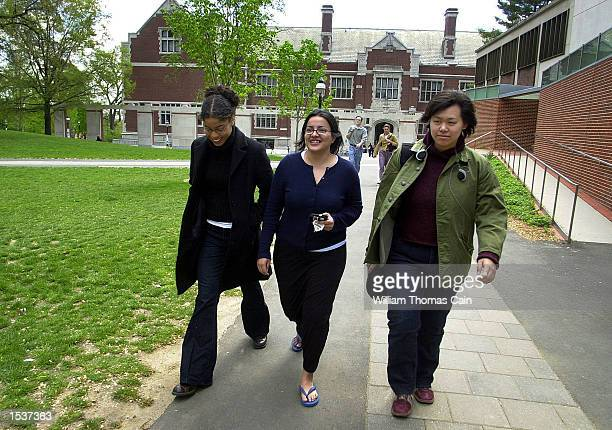 Students Dee Dee Aubourg from Davis CA Jennifer Morton from Lima Peru and Cindy Chou from Los Angeles CA walk on the campus of Princeton University...