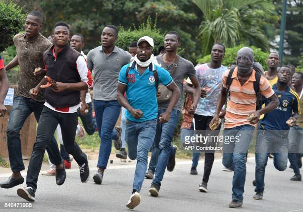 TOPSHOT Students demonstrating against the increase of registration fees run away as police try to disperse the crowd near a university campus...