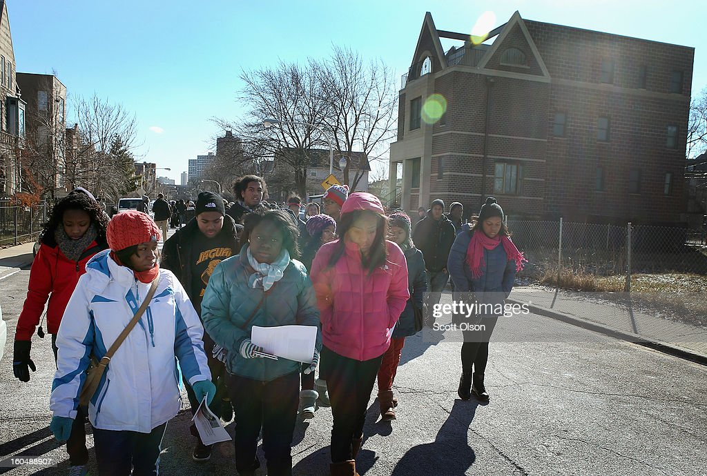 Students distribute flyers in the neighborhood around Harsh park which ask for help in finding the killer of Hadiya Pendleton on February 1, 2013 in Chicago, Illinois. Pendleton, a fifteen-year-old honor student at nearby King School, was shot and killed while hanging out with friends on a rainy afternoon under a shelter in the park on January 29. A $30,000 reward has been raised to help find her killer. Pendleton was the 44th homicide recorded in Chicago for 2013.