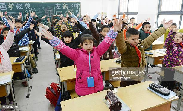 Students do exercises in the classroom at a primary school on December 7 2015 in Zhengzhou China China's National Meteorological Center issued a...