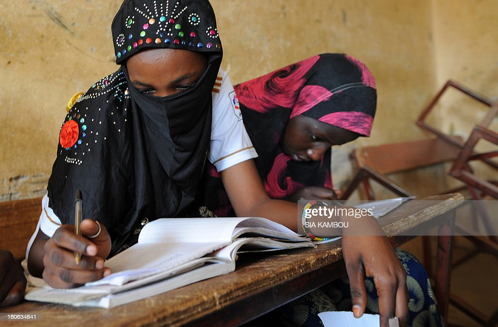 Students do work in a classroom in Gao, in the north of Mali, on the first day of the reopening of schools after the French bombing of Islamist targets, on February 4, 2013. Schools reopened today in Gao after the town was taken on January 26 by French and Malian forces from Islamists who had been occupying it for the last year.