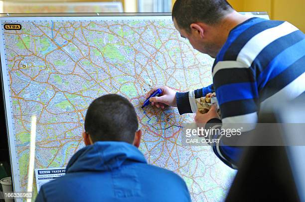 Students draw a route on a map of London in a test centre in north London on February 28 2013 All London Black Cab drivers are required to pass the...