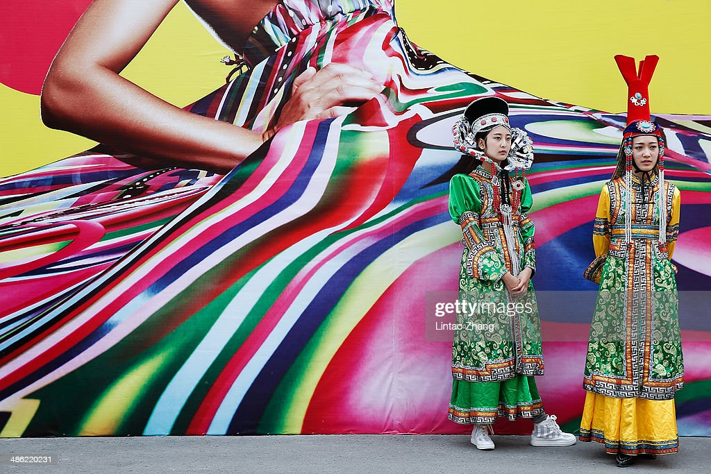 Students dressed in ethnic clothing before during the Minzu University Of China Graduates Show of 2014 China Graduate Fashion Week at the 751D-PARK on April 23, 2014 in Beijing, China.