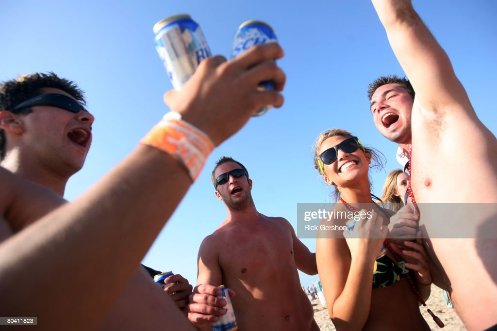 Students drink on the beach during the annual ritual of Spring Break March 25 2008 on South Padre Island Texas The South Texas island is one of the...