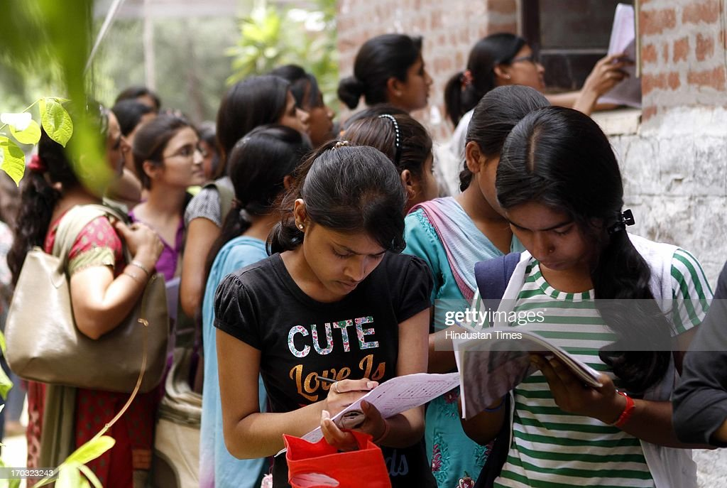 Students during the admission process for the new four-year undergraduate courses for academic year 2013-14 at Delhi University on June 10, 2013 in New Delhi, India.