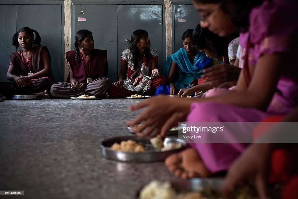 Students eat during lunch at the Aarti Home shelter on February 23, 2013 in Kadapa, India. Female infanticide is still prevalent in rural areas of India. The abuse of the dowry tradition has been one of the main reasons for sex-selective abortions and female infanticides in India.